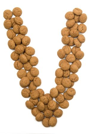 Little ginger nuts in the form of the letter V. These little ginger nuts are used in Holland for the Sinterklaas party, which is at Dec 5 every year. Sinterklaas is a sort of Santa Claus. In Holland these ginger nuts are called pepernoot. Isolated on