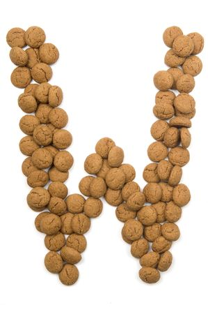 Little ginger nuts in the form of the letter W. These little ginger nuts are used in Holland for the Sinterklaas party, which is at Dec 5 every year. Sinterklaas is a sort of Santa Claus. In Holland these ginger nuts are called pepernoot. Isolated on