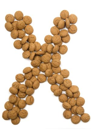 Little ginger nuts in the form of the letter X. These little ginger nuts are used in Holland for the Sinterklaas party, which is at Dec 5 every year. Sinterklaas is a sort of Santa Claus. In Holland these ginger nuts are called pepernoot. Isolated on
