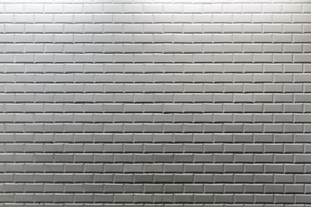 Tiles background of Paris metro station wall
