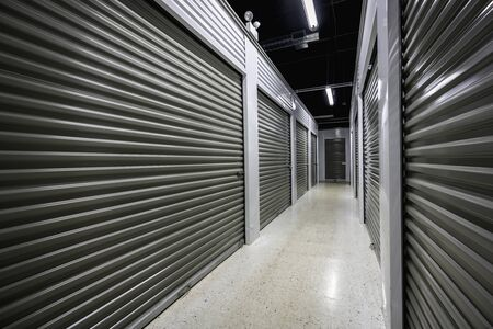 Photo for Long storage facility corridor. Garage doors with light - Royalty Free Image