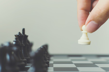Photo pour Plan leading strategy of successful business competition leader concept, Hand of player chess board game putting white pawn, Copy space for your text - image libre de droit