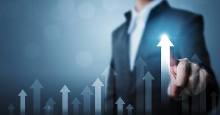 Foto de Business development to success and growing growth concept. Businessman pointing arrow graph corporate future growth plan - Imagen libre de derechos