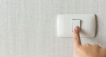 Foto de Concept save energy. Hand turning off switch - Imagen libre de derechos
