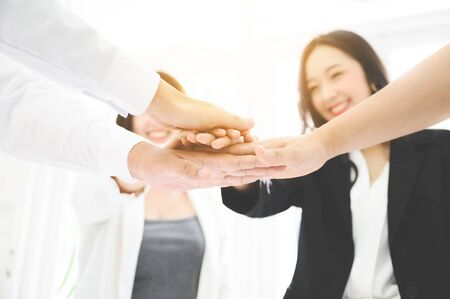 Teamwork together of business people. Combining power and encouragement
