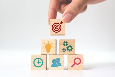 Photo for Concept of business strategy and action plan. Hand putting wooden cube block stacking with icon on white background - Royalty Free Image