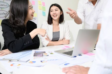 Photo for Group young asian businesswoman and businessman people have fun and talking or discuss about work in workplace - Royalty Free Image
