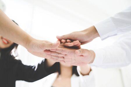 Business team teamwork join hands partnership concept