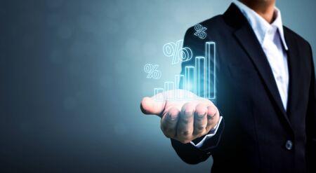 Foto de Interest rate financial and mortgage rates concept. Businessman hand show icon percent 3d sign with graph indicator - Imagen libre de derechos