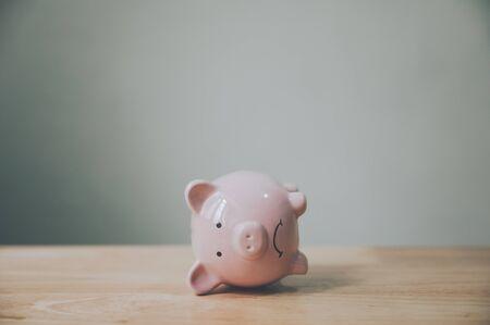 Photo pour Piggy bank on wood table. Financial investment and save money concept - image libre de droit