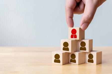 Photo pour Human resource management and recruitment business concept, Hand putting wood cube block on top pyramid, Copy space - image libre de droit