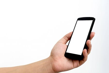 Photo pour Mockup image of hand holding mobile phone with blank screen white colour smartphone on white background. Clipping path included - image libre de droit