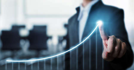 Photo pour Businessman pointing arrow graph corporate future growth plan with blurred background office. Business development to success and growing growth concept. - image libre de droit
