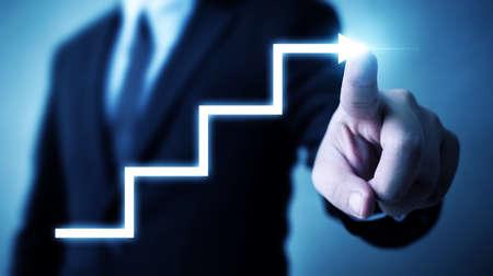 Photo pour Business development to success and growing annual revenue growth concept, Businessman pointing arrow step staircase corporate future growth plan - image libre de droit