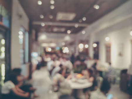 Photo pour Blurred images of the coffee shop cafe interior background and lighting bokeh - image libre de droit