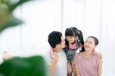 Photo for Happy asian family people leisure in bedroom together. Father and mother with daughter relaxing on bed and enjoy funny - Royalty Free Image