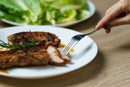 Photo pour Pork juicy steak grill with vegetables and spices. - image libre de droit