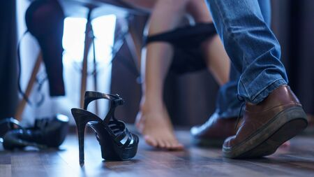 Photo pour Body part. Couple feel romantic  in bedroom, woman take off panties for him with black heels shoes on the floor. Sex concept. - image libre de droit