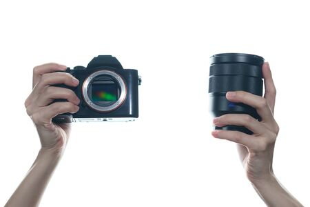 Photo for Woman hand holding camera and lens on white background. - Royalty Free Image
