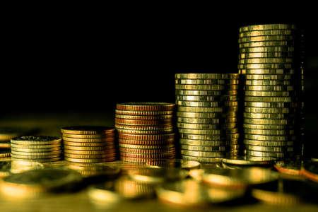 Photo pour Stack of gold coins on dark background. - image libre de droit