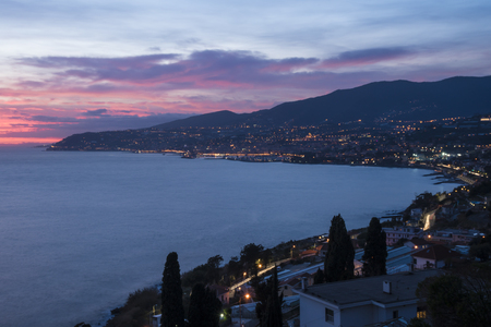 Photo pour Night panorama of the Italian coast with the city of Sanremo in the background. - image libre de droit
