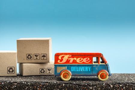 Foto de Free delivery van, vintage toy truck - Imagen libre de derechos