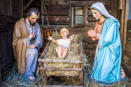 Christmas nativity scene represented with statuettes of Mary, Joseph and baby Jesus