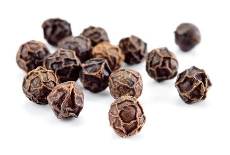 Peppercorn isolated. Peppercorns on white background. Black pepper macro. Soft focus.