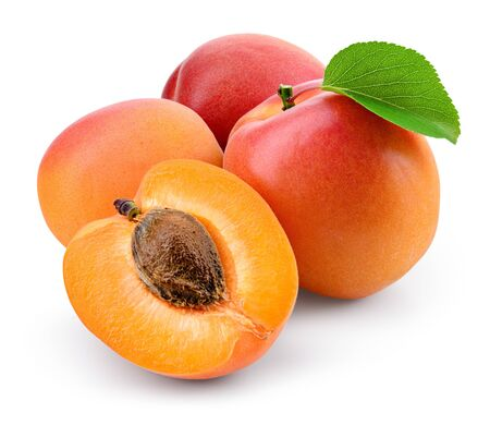 Apricots with slice on white.