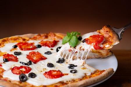 slice pizza  with buffalo mozzarella on wood backgrounds