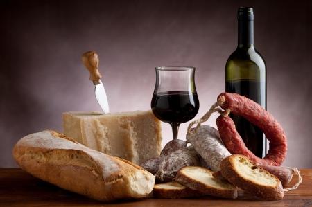 italian salami parmesan cheese bread and wine