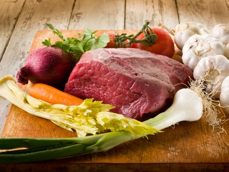 meat with vegetables ingredients over cutting board