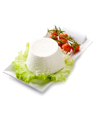 ricotta with tomatoes and lettuce on dish