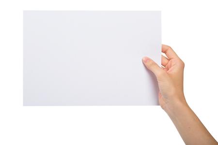 Foto de Hand holding a blank sheet of paper - Imagen libre de derechos