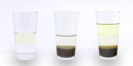 Photo pour Science experiment: heterogeneous mixture of water, oil and sand; water and oil; water and sand. - image libre de droit