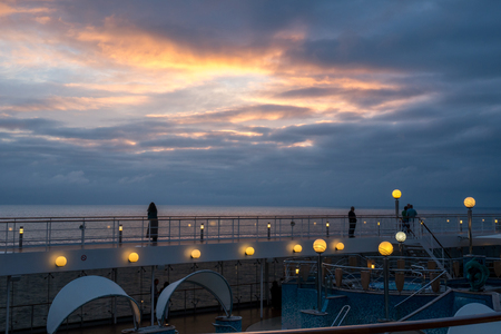 Photo for dramatic sunset seen from a cruiseship over the ocean water - Royalty Free Image