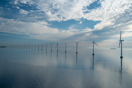 Photo pour offshore windmill park alternative energy. windmills in the sea with reflection in the morning, denmark copenhagen - image libre de droit