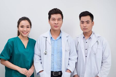 Photo pour Group of Asian medical workers/ doctors and nurse smiling at camera - image libre de droit