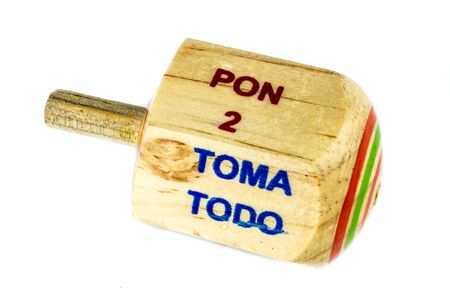 Traditional pirinola mexican handmade wooden toy with titles in spanish take all, put one, put two, everyone puts