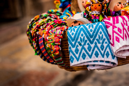 Basket of traditional dolls and mexican crafts