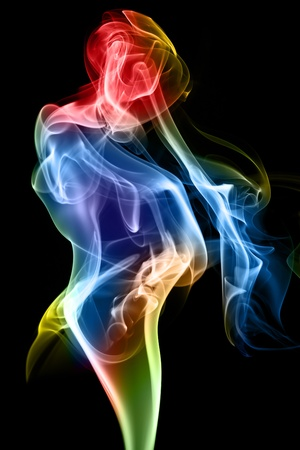 Female figure formed of fine smoke on a black background.