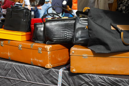 Nice, France - 17 September 2018: Secondhand suitcases and variety of bags are presented at the flea market in Cours Saleya, the famous city market offering antiques and many other products.のeditorial素材