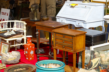 Photo for Nice, France - 17 September 2018: Second hand furniture and other interior furnishings are visible at the flea market in Cours Saleya, the famous city market offering antiques and many other products. - Royalty Free Image