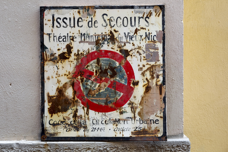 Nice, France - September 24, 2018: Prohibition sign appears to be significantly worn out, partially is rusty and there are many inscriptions on it