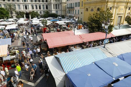 Nice, France - September 17, 2018: On business day many people came to the famous market called Cours Saleya. Most of the stalls were covered with canvas roofs to protect them from the sun's rays.