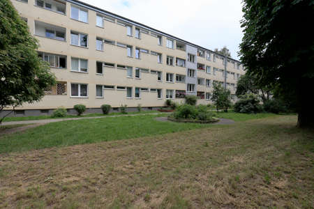 Photo pour Warsaw, Poland - June 16, 2020: Residential building is behind lawn and it is in the Saska Kepa district which is an area containing a large number of houses built close together. - image libre de droit