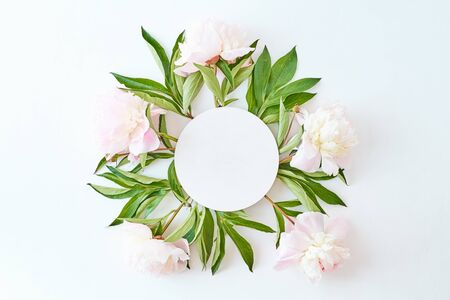 Photo for Mockup round white frame with light pink peonies on a white background - Royalty Free Image
