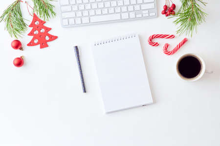 Photo pour Mockup white notebook with pine branches and keyboard, christmas decorations on a white background - image libre de droit