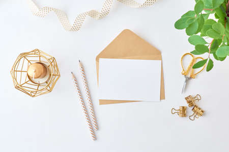 Photo for Mockup white greeting card and envelope with branches with green leaves on a light background - Royalty Free Image