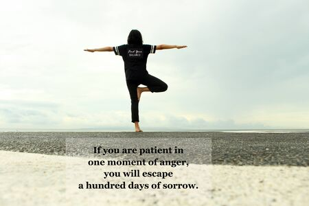 Foto de Inspirational quote - If you are patient in one moment of anger, you will escape a hundred days of sorrow. with tree yoga pose of a young woman against the ocean and blue sky view background. Buddha words of wisdom concept. - Imagen libre de derechos
